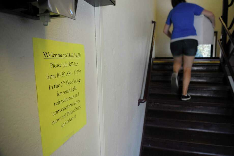 A welcoming message is posted on the wall in one of the dorm buildings as a new student moves in during freshman move-in day at RPI on Tuesday, Aug. 21, 2012 in Troy, NY.  This year's incoming class is 1,342 students, 371 of them women.  (Paul Buckowski / Times Union) Photo: Paul Buckowski