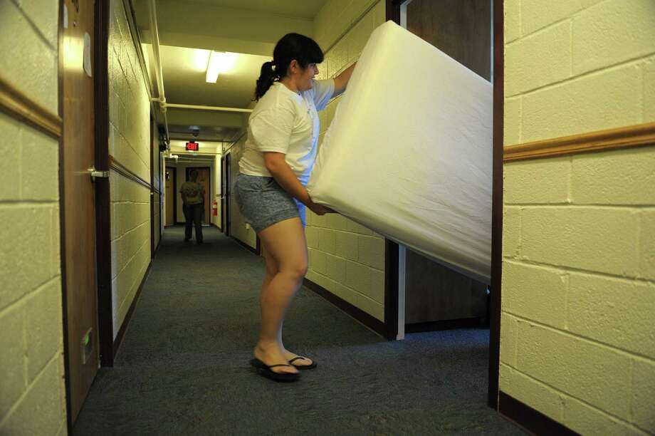 Freshman Priscilla Acosta from Miami moves a mattress into her dorm room during freshman move in day at RPI on Tuesday, Aug. 21, 2012 in Troy, NY.    (Paul Buckowski / Times Union) Photo: Paul Buckowski