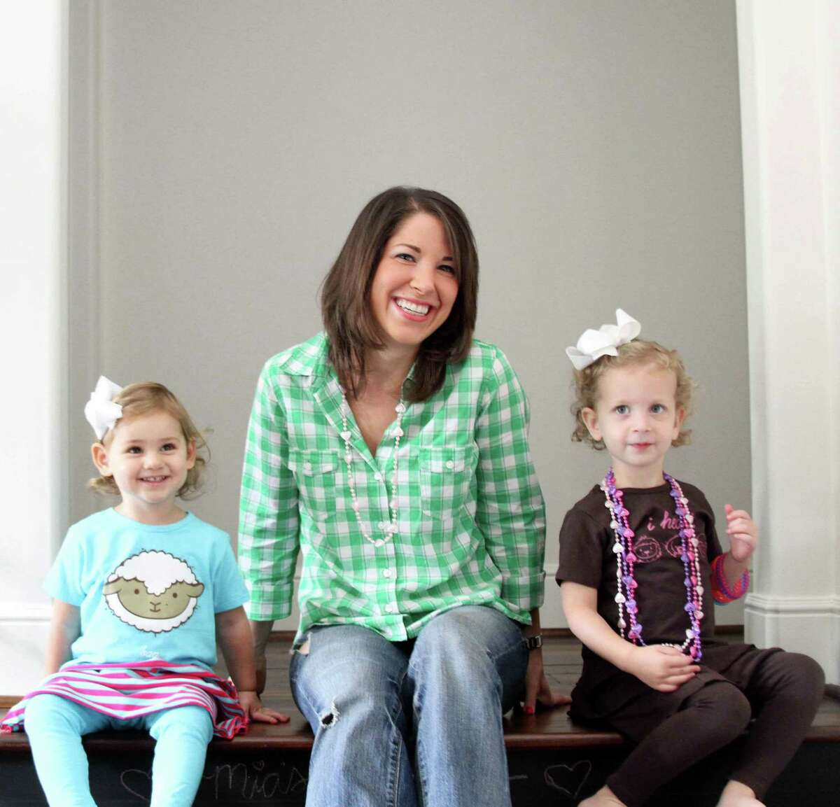 Esther Freedman, shown with Mia Laviage, 2, recently launched the Cuteheads.com online boutique for children's clothing.