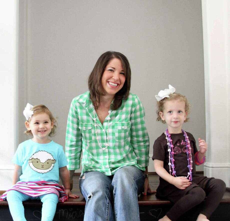 Esther Freedman, shown with Mia Laviage, 2, recently launched the Cuteheads.com online boutique for children's clothing. Photo: Cuteheads.com