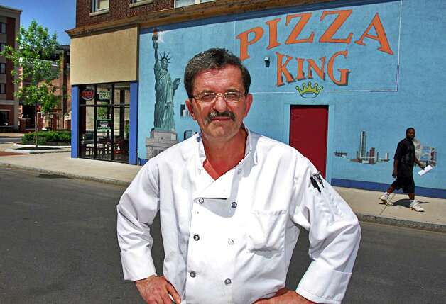 John Camaj outside the Clinton Avenue side of his Pizza King pizzeria in downtown Schenectady, May 30, 2007. (John Carl D'Annibale/Times Union) Photo: John Carl D'Annibale / Albany Times Union