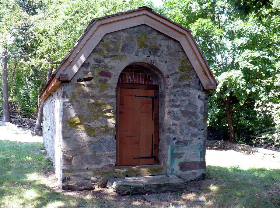 The Powder House, tucked away behind Tomlinson Middle School, was built after the War of 1812 to store the town's munitions. Fairfield CT. Aug. 14, 2012. Photo: Contributed Photo / Fairfield Citizen contributed