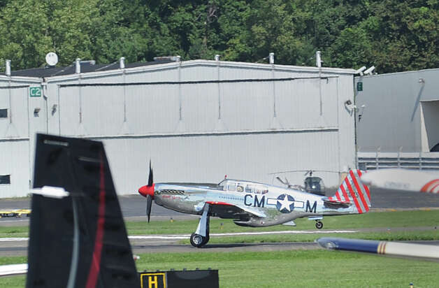 A P-51 Mustang fighter takes off during the annual World War II plane traveling exhibition, Wings of Freedom tour, at Westchester County Airport in White Plains, N.Y., Tuesday, Aug. 21, 2012. Photo: Bob Luckey / Greenwich Time