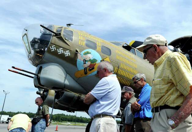 Spectators view a B-17 Flying Fortress bomber during the annual World War II plane traveling exhibition, Wings of Freedom tour, at Westchester County Airport in White Plains, N.Y., Tuesday, Aug. 21, 2012. Photo: Bob Luckey / Greenwich Time