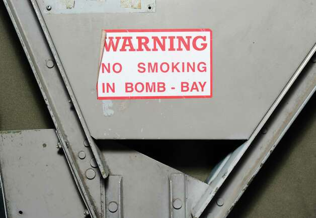 """Warning, No Smoking In Bomb Bay"" sign inside a B-24 Liberator during the annual World War II plane traveling exhibition, Wings of Freedom tour, at Westchester County Airport in White Plains, N.Y., Tuesday, Aug. 21, 2012. Photo: Bob Luckey / Greenwich Time"