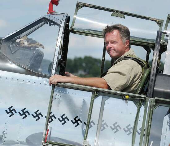 Jim Harley of Akron, Ohio, in the cockpit of a P-51 Mustang fighter during the annual World War II plane traveling exhibition, Wings of Freedom tour, at Westchester County Airport in White Plains, N.Y., Tuesday, Aug. 21, 2012. Photo: Bob Luckey / Greenwich Time