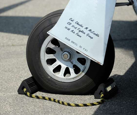 The wheel to a P-51 Mustang fighter during the annual World War II plane traveling exhibition, Wings of Freedom tour, at Westchester County Airport in White Plains, N.Y., Tuesday, Aug. 21, 2012. Photo: Bob Luckey / Greenwich Time