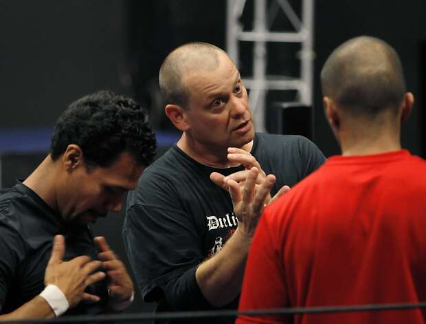 Dave Maier (middle) is no stranger to choreographing violence, but did some research before learning the ropes of professional wrestling with Tony Sancho (left) and Nasser Khan. Photo: Carlos Avila Gonzalez, The Chronicle