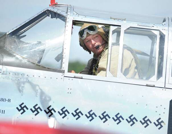 Jim Harley of Akron, Ohio, pilots a P-51 Mustang fighter during the annual World War II plane traveling exhibition, Wings of Freedom tour, at Westchester County Airport in White Plains, N.Y., Tuesday, Aug. 21, 2012. The aircraft will be on display and available for paid flights from 9 a.m. to noon Aug. 22, before leaving the airport. Photo: Bob Luckey / Greenwich Time
