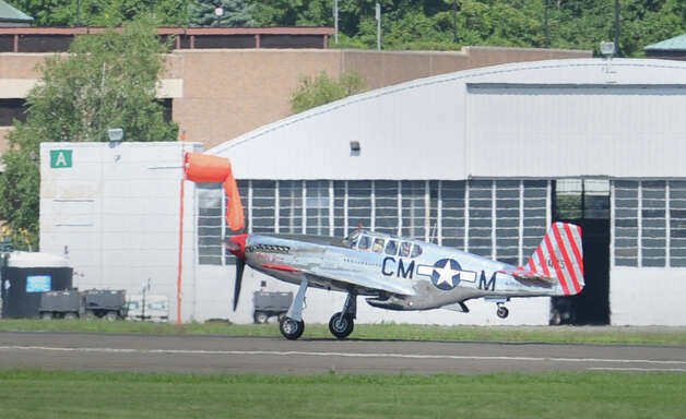 The P-51 Mustang fighter carrying Michael Harrison of Kent, N.Y., takes off during the annual World War II plane traveling exhibition, Wings of Freedom tour, at Westchester County Airport in White Plains, N.Y., Tuesday, Aug. 21, 2012. Harrison paid $2,200 for a half-hour flight. The aircraft will be on display and available for paid flights from 9 a.m. to noon Aug. 22, before leaving the airport. Photo: Bob Luckey / Greenwich Time