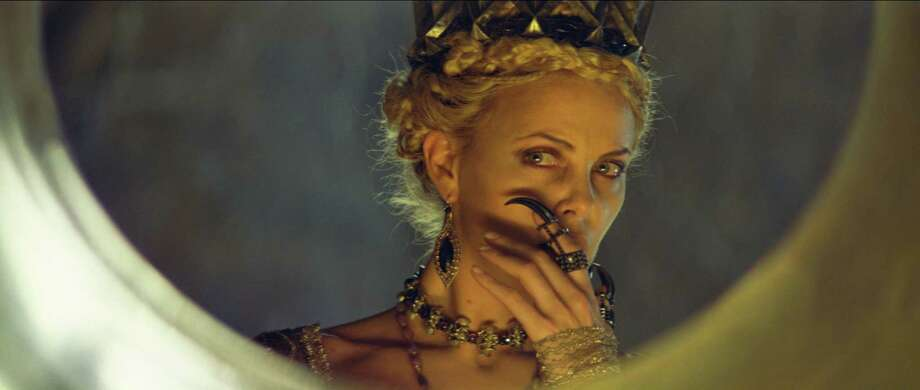 "Some people, such as the evil queen portrayed by Charlize Theron in ""Snow White and the Huntsman,"" can't help but look in the mirror. Photo: --"