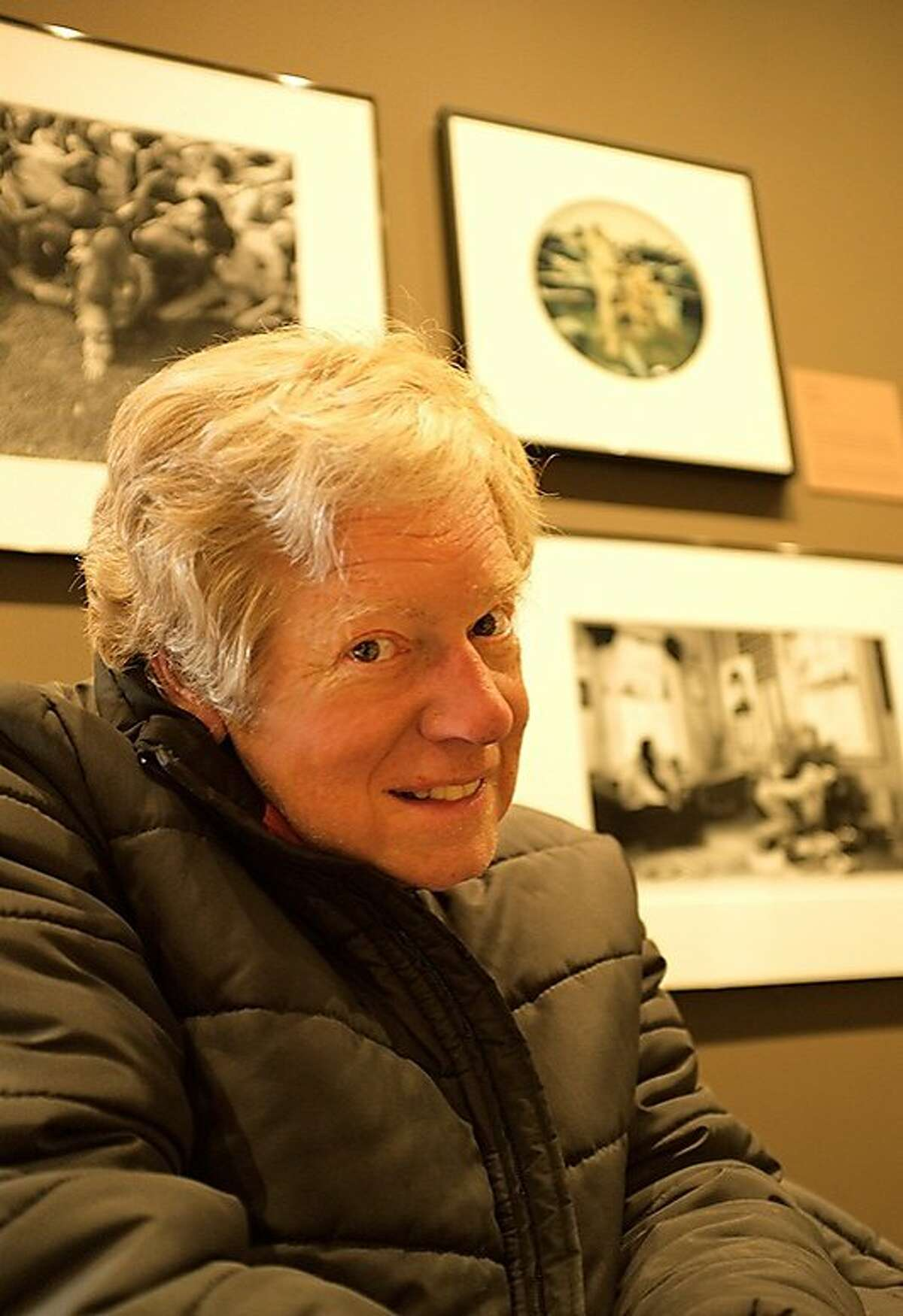 Photographer Larry Keenan in front of his work during a 2011 exhibition at the Oakland Museum of California.