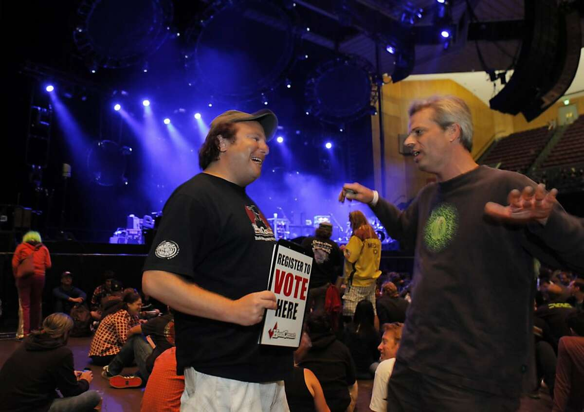 Johathan Shensa, left, with Head Count, speaks with Ned Sykes of Sacramento at the Phish show before the concert. Members of Head Count registered voters at the Phish show in San Francisco, Calif., on Sunday, August 19, 2012. Head Count is one of a rash of organizations that tried to connect w/young voters through music that were born out of the 2004 prez election -- and one of few still standing and thriving. This year they are partnering with 100 bands who are touring the U.S., and trying to get young people to register at the shows.