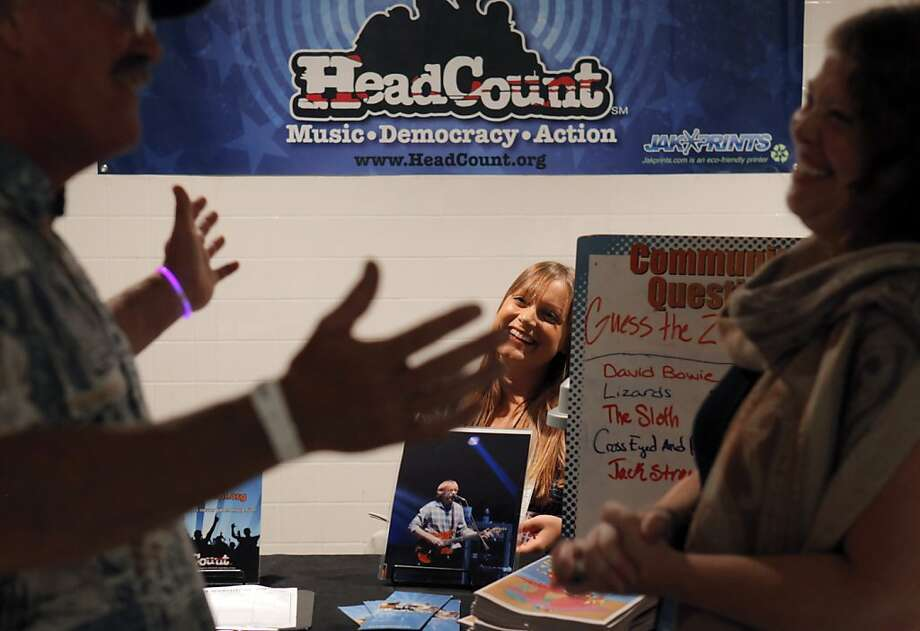 Carissa Fernandez (rear) listens as her HeadCount colleague Laura Scalet talks to Phish fan Steve Beals of Truckee on Sunday at the Bill Graham Civic Auditorium. Photo: Carlos Avila Gonzalez, The Chronicle