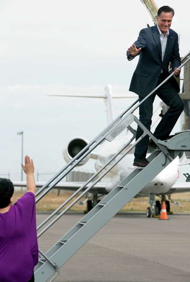 "Mitt Romney, the Republican presidential candidate, boards a plane to fly to a campaign event in Pueblo, Colo., in Denver, Sept. 24, 2012. Both presidential campaigns have new ads out this week, but the themes are familiar, with the Obama campaign tying Romney's tax returns to his ""47 percent"" comments and the Romney campaign attacking Obama's China policy. Photo: STEPHEN CROWLEY, New York Times / NYTNS"