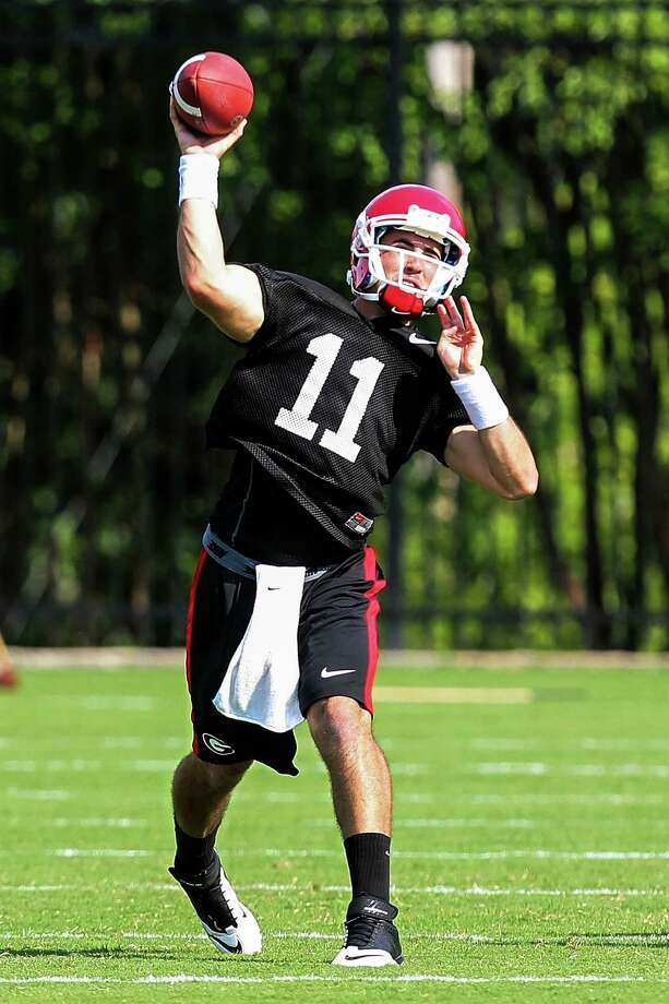 Georgia quarterback Aaron Murray (11) throws a pass during NCAA college football practice, Thursday, Aug. 2, 2012, in Athens, Ga. Photo: Daniel Shirey, Associated Press / FR170656 AP