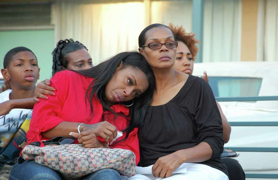 Anne Carter Winters, right, comforts her daughter, Teresa Carter, at a vigil for their grandson and son, Chavis Carter, in Memphis, Tenn., on Monday, Aug. 20, 2012. Chavis Carter, a man police say shot himself in the head while his hands were cuffed behind him in the back of an Arkansas patrol car, tested positive for methamphetamine, anti-anxiety medication and other drugs, according to an autopsy report released Monday that listed his death as a suicide. (AP Photo/Jeannie Nuss) Photo: Jeannie Nuss / AP