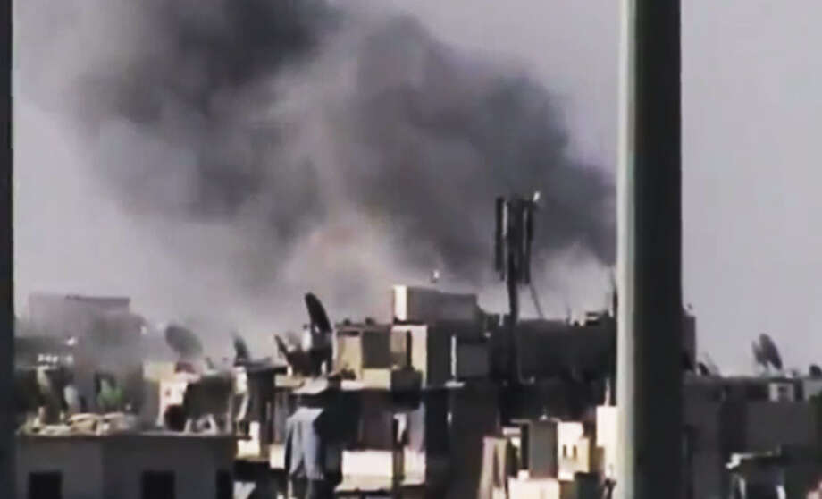 FILE - This Tuesday, July 31, 2012 file photo image made from amateur video released by the Ugarit News purports to show black smoke rising from buildings in Aleppo, Syria. Its forces stretched thin on multiple fronts, President Bashar Assad's regime has significantly increased its use of air power against Syrian rebels in recent weeks, causing mounting civilian casualties. The shift is providing useful clues about the capability of the air force as Western powers consider the option of enforcing a no-fly zone over the northern part of the country.(AP Photo/Ugarit News via AP video, File) THE ASSOCIATED PRESS IS UNABLE TO INDEPENDENTLY VERIFY THE AUTHENTICITY, CONTENT, LOCATION OR DATE OF THIS HANDOUT PHOTO Photo: Uncredited / AP