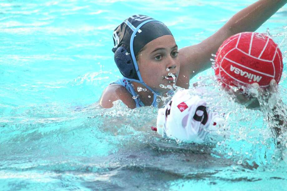 Defensive stalwart Paige Furano blocks a shot for YMCA Greenwich Aquatics 12U Girls Water Polo team during action at the National Junior Olympics, which were held recently in Palo Alto, Calif. Photo: Contributed Photo