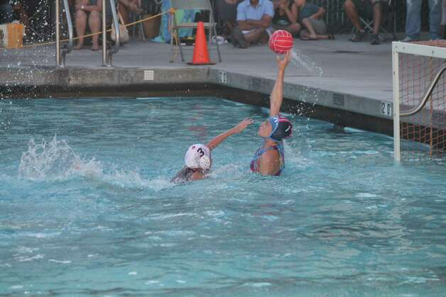 Goalie Lizzie Bradley makes a save for the YMCA Greenwich Aquatics 12U Girls Water Polo team during action at the National Junior Olympics, which were held recently in Palo Alto, Calif. Photo: Contributed Photo
