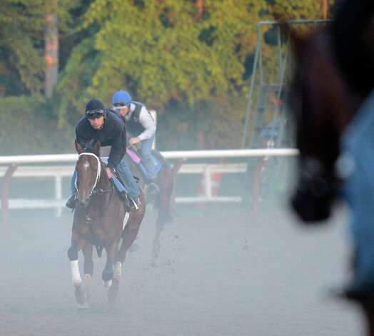 Jim Dandy winner Alpha with exercise rider Rob Massey, center takes to the track this morning approximately 6:00 am for his morning exercise on the main track at the Saratoga Race Course in Saratoga Springs, N.Y. Aug 21, 2012.   (Skip Dickstein/Times Union) Photo: Skip Dickstein