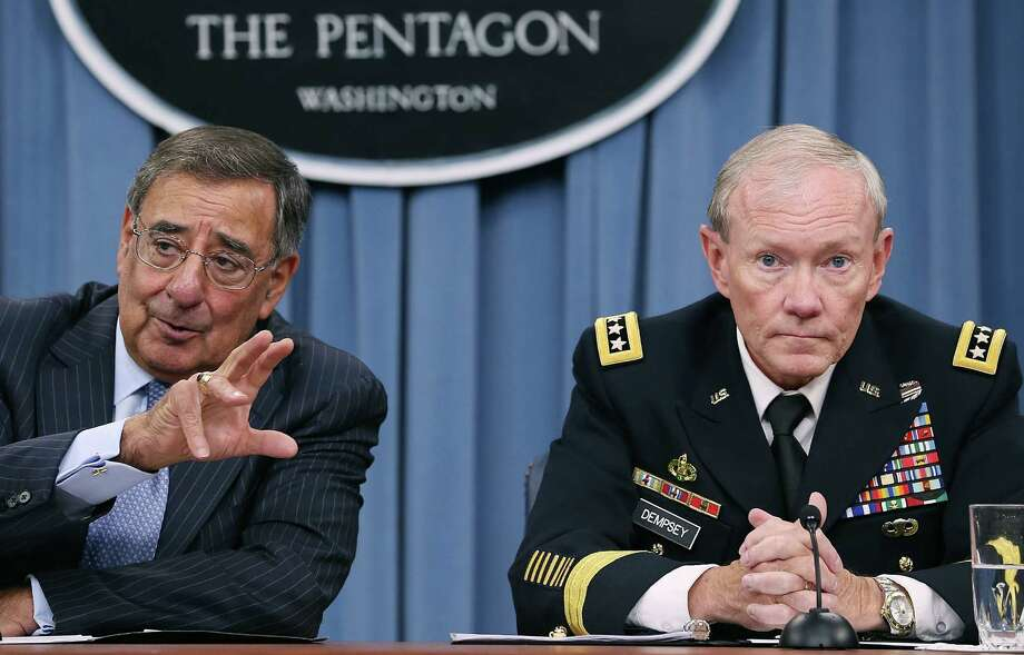 ARLINGTON, VA - AUGUST 14:  U.S. Secretary of Defense Leon Panetta (L), and Chairman of the Joint Chiefs of Staff Gen. Martin Dempsey speak to the media during a briefing at the Pentagon, on August 14, 2012 in Arlington, Virginia. Secretary Panetta spoke on various topics including in Syria, Iran and Afghanistan.  (Photo by Mark Wilson/Getty Images) Photo: Mark Wilson / 2012 Getty Images