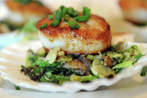 Scallops wrapped in pancetta with brussels sprouts, shiitake mushrooms and chives at Cesco's Trattoria in Darien, Conn., August 2, 2012. Photo: Keelin Daly / Stamford Advocate