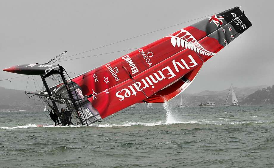 Emirates Team New Zealand rights their vessel after a capsize  on San Francisco Bay, Calif. on Tuesday August 21, 2012, during racing practice for the 2012 America's Cup World Series. Photo: Michael Macor, The Chronicle