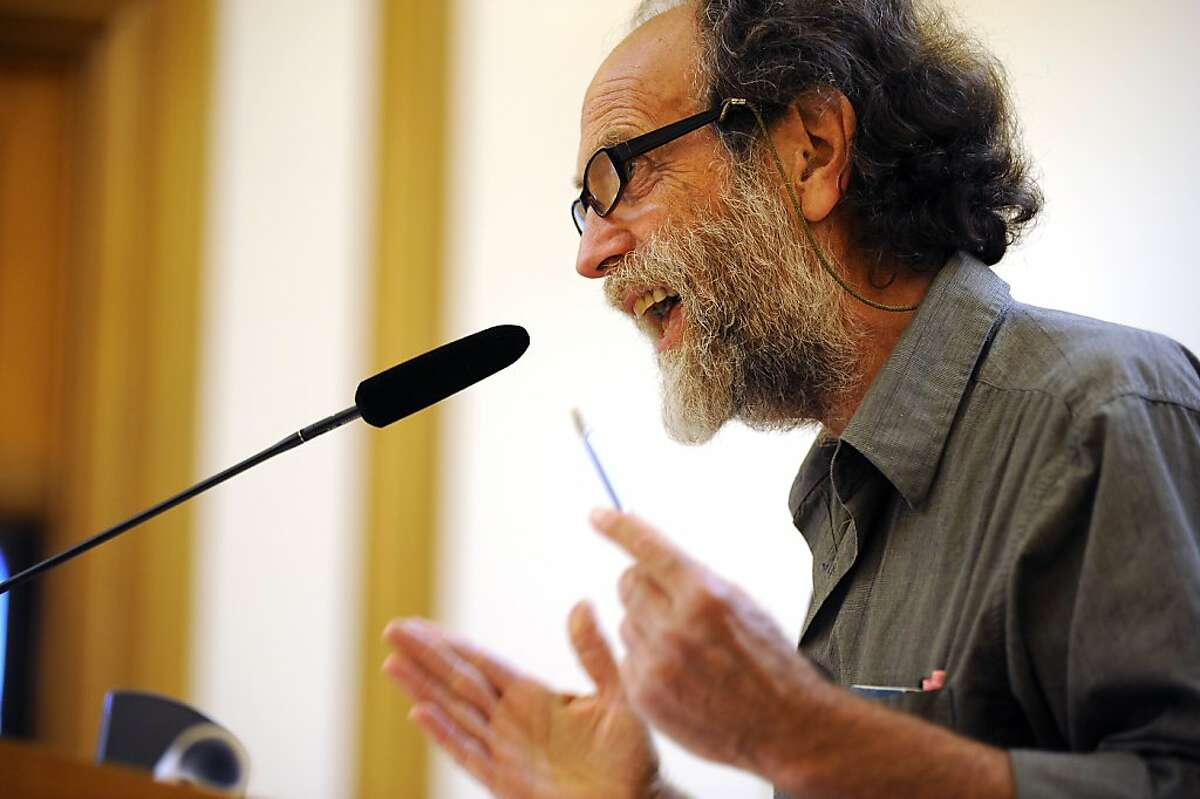 Mark Gruberg, a spokesperson for the United Taxicab Workers, speaks to the Board during the public comments portion of the meeting. The Municipal Transportation Agency voted on changes to the SF Taxi Driver Medallion system at City Hall in San Francisco, CA Tuesday August 21st, 2012.