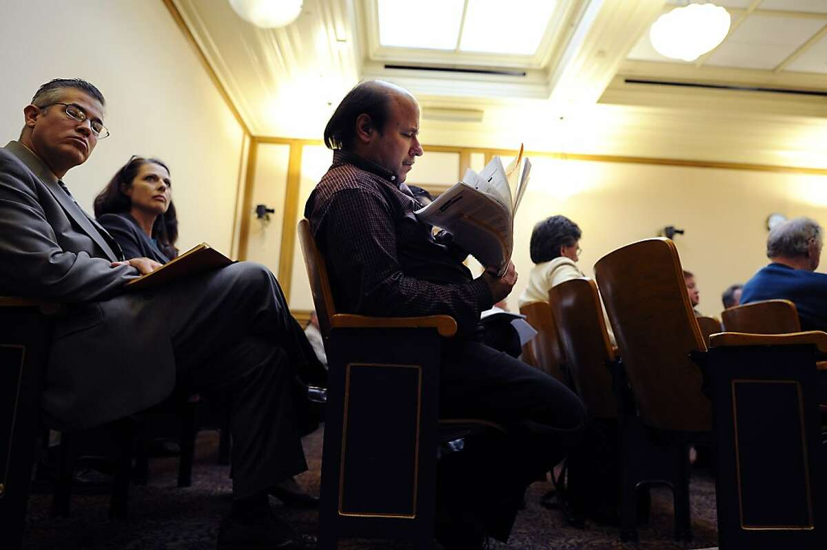 Barry Taranto(center), a taxi driver advocate, organizes his paperwork while waiting to speak. The Municipal Transportation Agency voted on changes to the SF Taxi Driver Medallion system at City Hall in San Francisco, CA Tuesday August 21st, 2012.