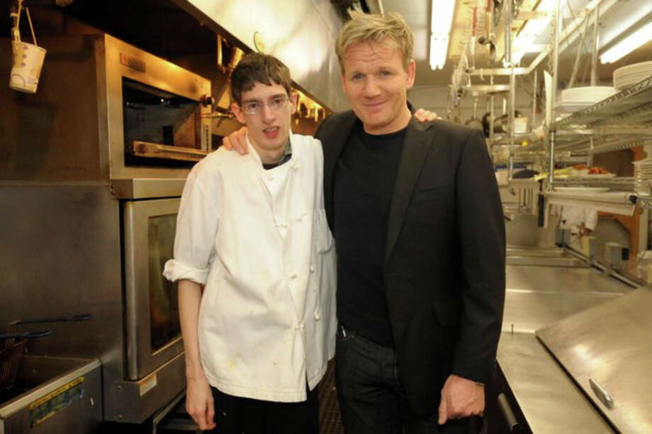 "Donald ?Scooter? Telford, a kitchen worker at the Cambridge Hotel, left, stands with Gordon Ramsay. Telford said he was happy with the way he was portrayed in Monday's ""Hotel Hell"" episode. (Telford Family photo)"