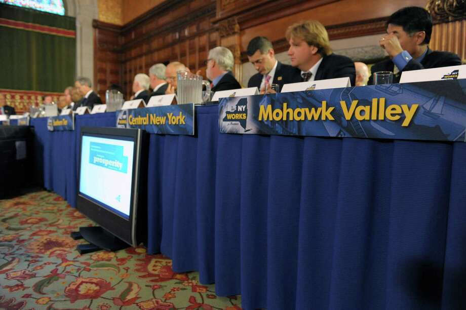 Name plates hang to designate representatives from different areas of the state as Governor Andrew Cuomo held a meeting with members of his economic development council at the Capitol on Tuesday, Aug. 21, 2012 in Albany, NY.  (Paul Buckowski / Times Union) Photo: Paul Buckowski