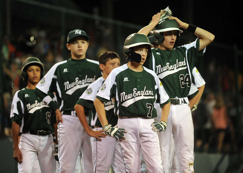 New England's #7 Ryan Meury stands stunned in front with the rest of his teammates after they were eliminated by West 5-0, during 2012 Little League World Series game action in South Williamsport, Penn. on Tuesday August 21, 2012. Photo: Christian Abraham / Connecticut Post