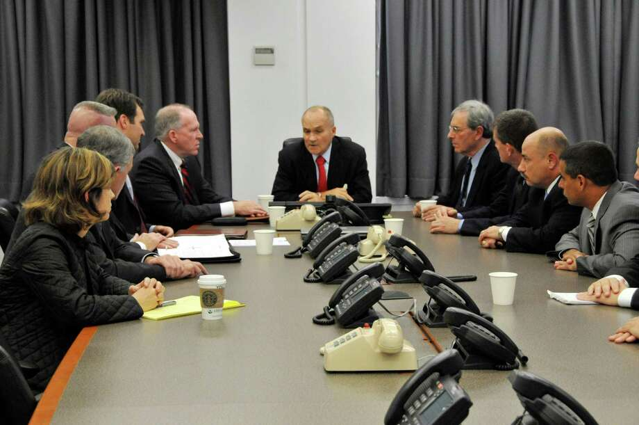 In this photo released by the New York City Police Department, NYC Police Commissioner Raymond Kelly, center, briefs other NYPD officials and John O. Brennan, assistant to the President for Homeland Security and Counterterrorism, center right, on events surrounding the alleged plot to bomb NYC commuter trains on Sept. 11, at Police Headquarters in New York, Saturday, Sept. 26, 2009. Seated at the table from left are Katherine Lemire, special council to the police commissioner; Deputy Inspector John Nicholson of the Joint Terrorism Task Force; Commanding Officer of the NYPD Counterterrorism Bureau, Assistant Chief James Waters; Deputy Commissioner of the Counterterrorism Bureau, Richard Falkenrath; John O. Brennan; Raymond Kelly; Deputy Commissioner of Intelligence, David Cohen; Commander of the Joint Terrorism Task Force, Deputy Chief James Shea; Lt. Joseph Falco of the Joint Terrorism Task Force and Assistant Chief Thomas Galati, who commands the Intelligence Division. In more than six years spying on Muslim neighborhoods, the New York Police Department's secret Demographics Unit never generated a lead or triggered a terrorism investigation. That's according to court testimony unsealed Monday, Aug. 20, 2012. The Demographics Unit is at the heart of a police spying effort built with help from the CIA. The unit created databases on where Muslims lived, shopped, worked and prayed. As part of a longstanding federal civil rights case, Galati offered the first official look at the unit. Galati testified as part of a lawsuit over police spying on students, civil rights groups and suspected Communist sympathizers during the 1950s and 1960s. (AP Photo/NYPD) Photo: Anonymous