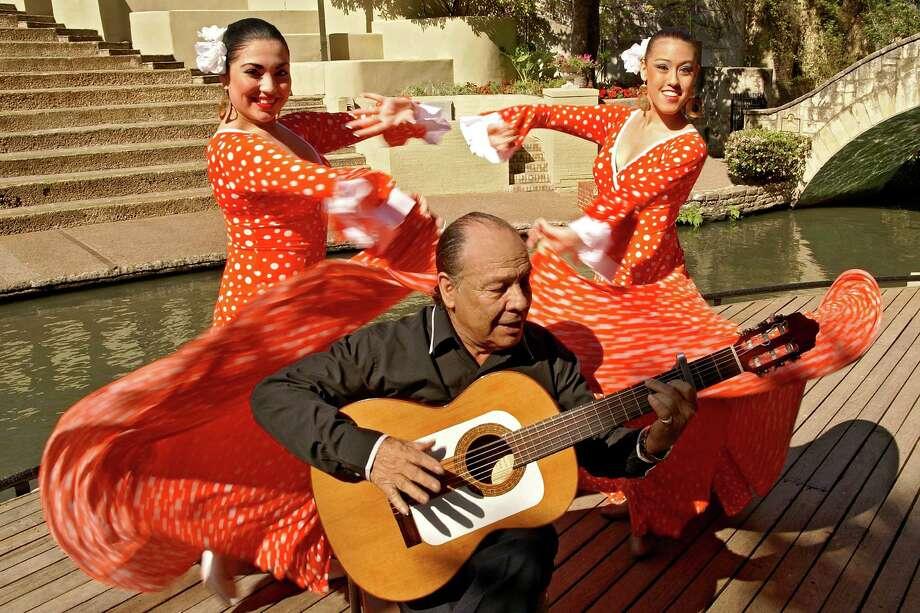 "Guitarist Willie ""El Curro"" Champion performed with Fiesta Noche del Rio earlier this year. Photo: AL RENDON"