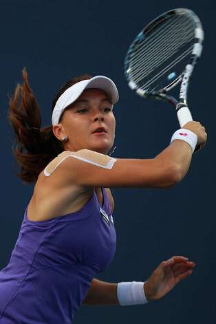 NEW HAVEN, CT - AUGUST 21:  Agnieszka Radwanska of Poland returns a shot from Olga Govortsova of Belarus during the New Haven Open at Connecticut Tennis Center at Yale on August 21, 2012 in New Haven, Connecticut.  (Photo by Joe Scarnici/Getty Images) Photo: Joe Scarnici, Getty Images / 2012 Getty Images