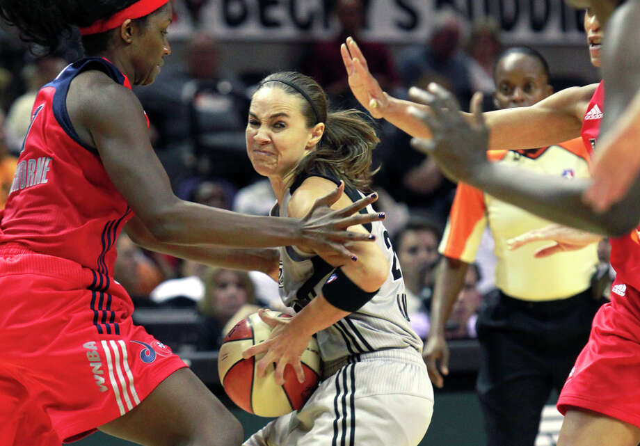Becky Hammon gets snagged in the defense on the outside as the Silver Stars host the Washington Mystic at the AT&T Center on August 21, 2012. Photo: Tom Reel, San Antonio Express-News / ©2012 San Antono Express-News