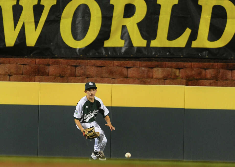 New England's Ryan Meury scrambles for a West ball sent to center field, during 2012 Little League World Series game action in South Williamsport, Penn. on Tuesday August 21, 2012. West beat New England 5-0. Photo: Christian Abraham / Connecticut Post