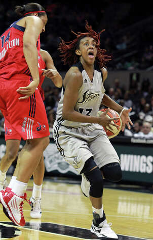 San Antonio guard Danielle Robinson looses the ball after being popped by Lindsay Wisdom-Hylton as the Silver Stars host the Washington Mystic at the AT&T Center on August 21, 2012. Photo: Tom Reel, Express-News / ©2012 San Antono Express-News