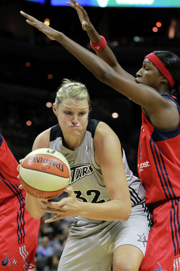 San Antonio's Jane Appel moves to the hoop against Michelle Snow  as the Silver Stars host the Washington Mystic at the AT&T Center on August 21, 2012. Photo: Tom Reel, Express-News / ©2012 San Antono Express-News