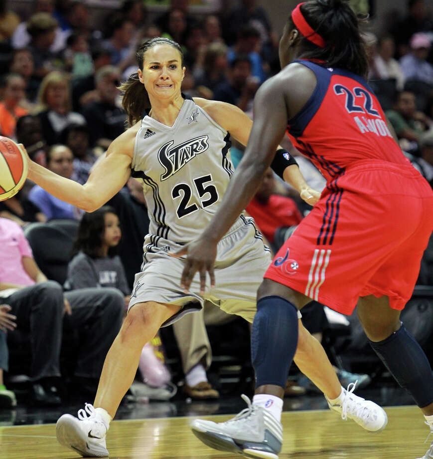Becky Hammon makes a hard pass to the insodie past Matee Ajavon as the Silver Stars host the Washington Mystic at the AT&T Center on August 21, 2012. Photo: Tom Reel, Express-News / ©2012 San Antono Express-News