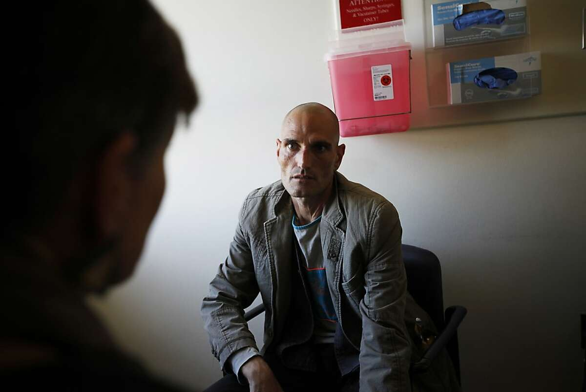 """Joey """"August"""" Massey, HIV-positive patient, listens to his doctor who is going to tell him the new test results. Pictured at SF General San Francisco, Calif. on Tuesday, Aug 21, 2012."""