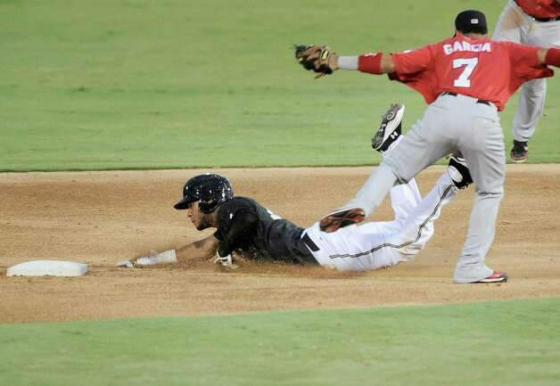 Jonathan Galvez (left) of the Missions is tagged out by Frisco's Leury Garcia as he tries to steal second. Photo: Darren Abate, Darren Abate/For The Express-New