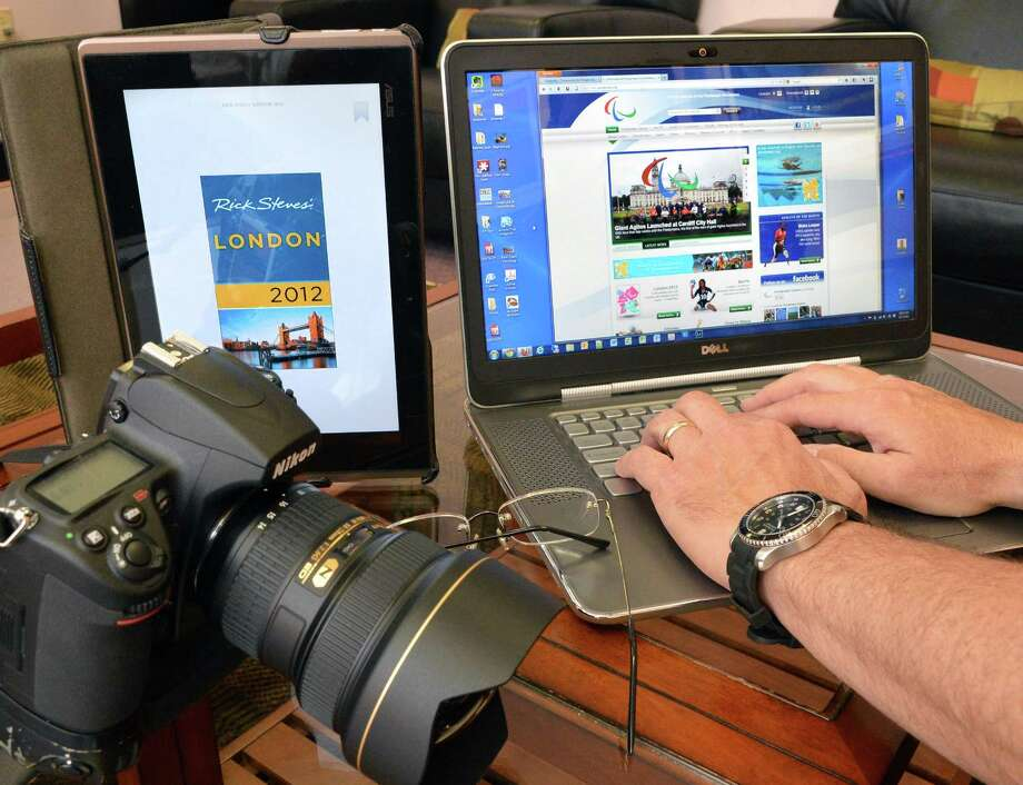 """Photographer Anthony Tassarotti plans his coverage of the upcoming Paralympic Games in London with John Robinson, founder of """"Our Ability"""" to highlight people with disabilities excelling during an interview in North Greenbush Friday Aug. 17, 2012.  (John Carl D'Annibale / Times Union) Photo: John Carl D'Annibale / 00018905A"""