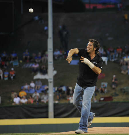 Weston little league coach Steve Esposito throws out the first pitch at the 2012 Little League World Series before game action between New England and West in South Williamsport, Penn. on Tuesday August 21, 2012. West beat New England 5-0. Photo: Christian Abraham / Connecticut Post