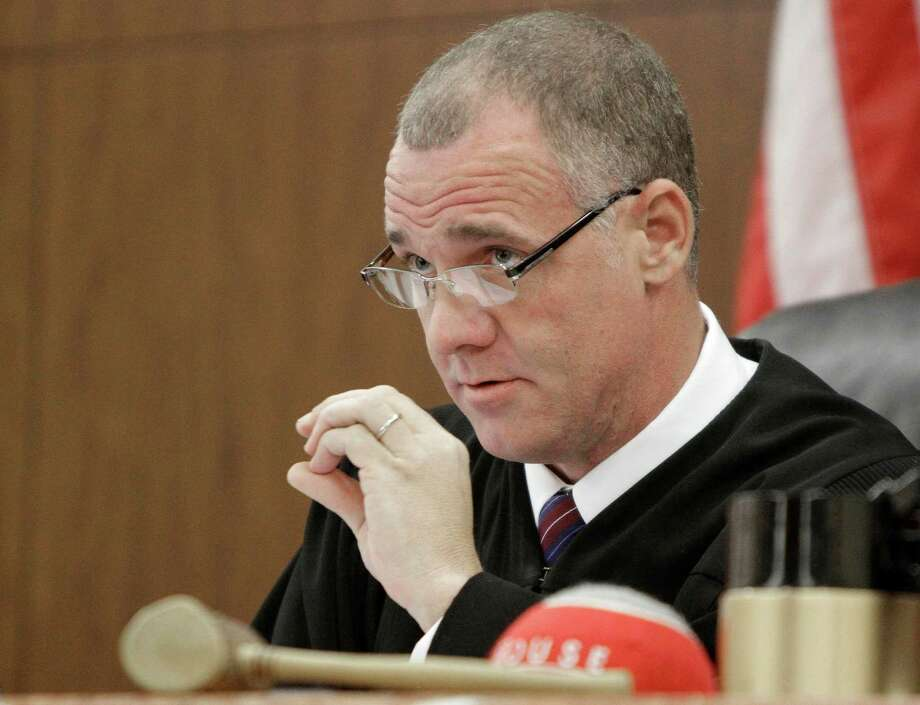 Texas District Court Judge Kevin Fine speaks during a hearing on the constitutionality of the death penalty Monday, Dec. 6, 2010 in Houston. While anti-death penalty groups have lauded Fine, those in favor of capital punishment have called him misguided. (AP Photo/Pat Sullivan) Photo: Pat Sullivan / AP