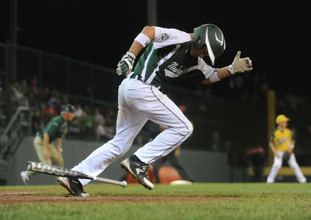 New England's Biagio Paoletta launches for first after a hit, during 2012 Little League World Series game action against West in South Williamsport, Penn. on Tuesday August 21, 2012. West beat New England 5-0. Photo: Christian Abraham / Connecticut Post