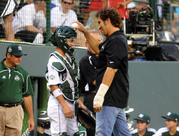 Goofing around, Weston little league coach Steve Esposito tap New England catcher Biagio Paoletta on the head with a baseball before the start of 2012 Little League World Series game action between New England and West in South Williamsport, Penn. on Tuesday August 21, 2012. Esposito threw out the ceremonial first pitch. West went on to beat New England 5-0. Photo: Christian Abraham / Connecticut Post