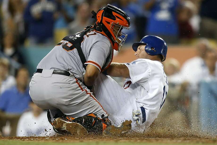 San Francisco Giants catcher Hector Sanchez, left, tags out Los Angeles Dodgers' A.J. Ellis in the sixth inning of a baseball game in Los Angeles, Tuesday, Aug. 21, 2012. (AP Photo/Jae C. Hong) Photo: Jae C. Hong, Associated Press