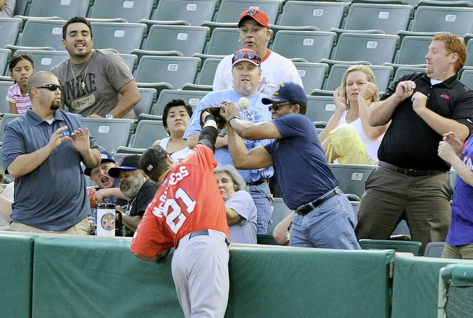Frisco Roughriders' Chris McGuiness (21) battles fans for a foul ball during a Texas League baseball game against the San Antonio Missions, Tuesday, Aug. 21, 2012, in San Antonio. Photo: Darren Abate, Express-News